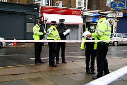 © Licensed to London News Pictures. 20/01/2021. London, UK. Police officers guard a murder scene on West Green Road in Haringey, north London as police launch a murder investigation following the fatal stabbing of a teenage boy in Haringey. Police were called at 21:10hrs on Tuesday 19 January 2021 to the West Green Road junction with Willow Walk, following reports of a stabbing. Officers attended with the London Ambulance Service and found a male, aged 17, suffering from a stab injury. The victim was pronounced dead at 04:25hrs on Wednesday 20 January. . Photo credit: Dinendra Haria/LNP