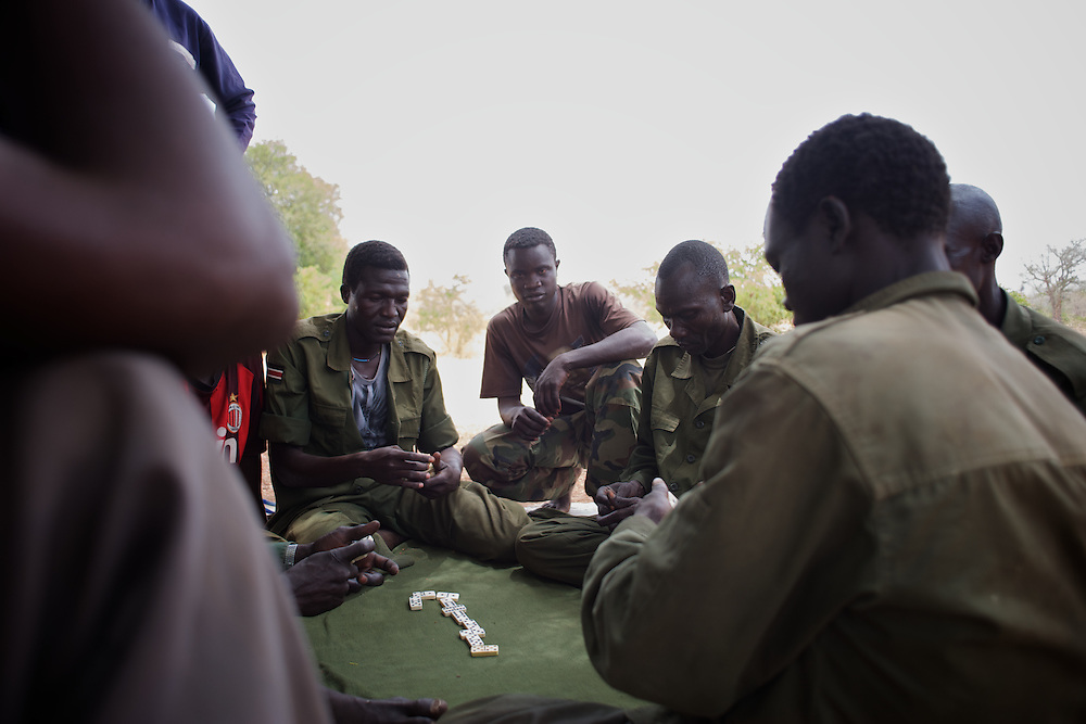 May 02, 2012 - Kauda, Nuba Mountains, South Kordofan, Sudan: A group of Sudan People?s Liberation Movement (SPLA-N) rebel fighters relax outside Jebel Kwo military base near Tess village in the rebel-held territory of the Nuba Mountains in South Kordofan. ..SPLA-North, a historical ally of SPLA, South Sudan's former rebel forces, has since last June being fighting the Sudanese Army Forces (SAF) over the right to autonomy and of the end of persecution of Nuba people by the regime of President Bashir. (Paulo Nunes dos Santos/Polaris)