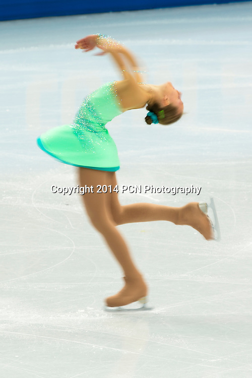 Burred action of woman competiting in the Women's Figure Skating Short Program at the Olympic Winter Games, Sochi 2014