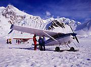 K2 owner Jim Okonek with McKinley climber and base camp Manager Norma Jean Green, K2 Aviation's Cessna 185s, Southeast Fork of Kahiltna Glacier, Denali National Park, Alaska.