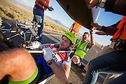 Alexey Kiristaev na de avondrun op de derde dag van de races. In Battle Mountain (Nevada) wordt ieder jaar de World Human Powered Speed Challenge gehouden. Tijdens deze wedstrijd wordt geprobeerd zo hard mogelijk te fietsen op pure menskracht. Het huidige record staat sinds 2015 op naam van de Canadees Todd Reichert die 139,45 km/h reed. De deelnemers bestaan zowel uit teams van universiteiten als uit hobbyisten. Met de gestroomlijnde fietsen willen ze laten zien wat mogelijk is met menskracht. De speciale ligfietsen kunnen gezien worden als de Formule 1 van het fietsen. De kennis die wordt opgedaan wordt ook gebruikt om duurzaam vervoer verder te ontwikkelen.<br /> <br /> In Battle Mountain (Nevada) each year the World Human Powered Speed Challenge is held. During this race they try to ride on pure manpower as hard as possible. Since 2015 the Canadian Todd Reichert is record holder with a speed of 136,45 km/h. The participants consist of both teams from universities and from hobbyists. With the sleek bikes they want to show what is possible with human power. The special recumbent bicycles can be seen as the Formula 1 of the bicycle. The knowledge gained is also used to develop sustainable transport.