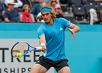 Tennis - 2019 Queen's Club Fever-Tree Championships - Day Three, Wednesday<br /> <br /> Men's Singles, First Round: Stefanos Tsitsipas (GRC) Vs. Kyle Edmund (GBR)<br /> <br /> Stefanos Tsitsipas (GRC) strikes the forehand return of serve on Centre Court.<br />  <br /> COLORSPORT/DANIEL BEARHAM