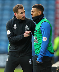 Huddersfield Town manager Jan Siewert (left) speaks with Huddersfield Town's Karlan Ahearne-Grant during the Premier League match at the John Smith's Stadium, Huddersfield.