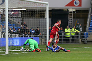 Lukas Jutkiewicz of Birmingham city gets the last touch as he beats Cardiff city goalkeeper Allan McGregor and scores his teams 1st goal to equalise at 1-1 . EFL Skybet championship match, Cardiff city v Birmingham City at the Cardiff City Stadium in Cardiff, South Wales on Saturday 11th March 2017.<br /> pic by Andrew Orchard, Andrew Orchard sports photography.