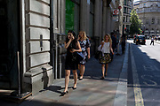 Women walk along on Threadneedle Street during the 2018 heatwave in the City of London, the capital's historic financial district, on 2nd August 2018, in London, England.