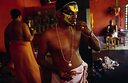 An actor pauses his make up for a snack before a performance at the Kerala Kalamandalam<br /> The Kalamandalam was founded in 1930 to preserve the cultural traditions of Kathakali, the stylised dance drama of Kerala. Kathakali is the classical dance-drama of Kerala, South India, which dates from the 17th century and is rooted in Hindu mythology. Kathakali is a unique combination of literature, music, painting, acting and dance performed by actors wearing extensive make up and elaborate costume who perform plays which retell in dance form stories from the Hindu epics.