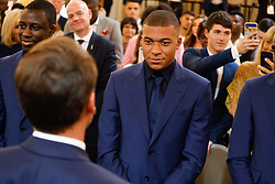 French president Emmanuel Macron embraces France's forward Kylian Mbappe during a ceremony to award French 2018 football World Cup winners with the Legion of Honour at the Elysee Palace in Paris, on June 4, 2019. Photo by Hamilton/pool/ABACAPRESS.COM