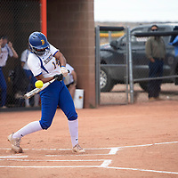 Amia Goins (14) bats for Bloomfield against the Gallup Bengals Friday afternoon at Gallup High School in Gallup.