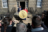 Members of the press taking photos to the Scottish Labour deputy leader Anas Sarwar and credit union leader worker Alison Dowling deliver a giant pound coin to Bute House.<br />  Scottish Labour deputy leader Anas Sarwar and credit union leader worker Alison Dowling deliver a giant pound coin to Bute House. The First Minister's official residence, to highlight uncertainty over what currency an independent Scotland would use.<br /> <br /> Pako Mera/Universal News And Sport (Europe) 07/08/2014