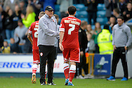 Cardiff City Manager Russell Slade with Peter Whittingham of Cardiff City after the final whistle.  Skybet football league championship match , Millwall v Cardiff city at the Den in Millwall, London on Saturday 25th October 2014.<br /> pic by John Patrick Fletcher, Andrew Orchard sports photography.