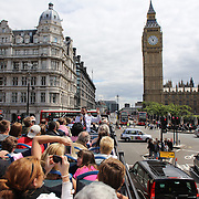 A London tour bus full of tourists approaches Big Ben and the Houses of Parliament. .Big Ben is to chime non-stop for three minutes to help ring in the London 2012 Olympics. Special permission had to be gained for the hour bell at the Palace of Westminster to toll out of its regular sequence. It will strike more than 42 times between 8.12am and 8.15am on 27 July to herald the beginning of the first day of Games. It will be the first time Big Ben has been rung outside its regular schedule since 15 February 1952, when it tolled every minute for 56 strokes for the funeral of King George VI. London 2012 Olympic games  London, UK. 15th July 2012. Photo Tim Clayton