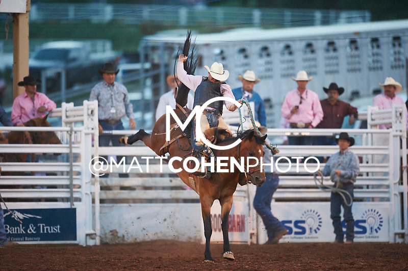 Saddle bronc rider Ty Thompson of Wanblee, SD rides Pepsi Valley at the Pikes Peak or Bust Rodeo in Colorado Springs, CO.<br /> <br /> <br /> UNEDITED LOW-RES PREVIEW<br /> <br /> <br /> File shown may be an unedited low resolution version used as a proof only. All prints are 100% guaranteed for quality. Sizes 8x10+ come with a version for personal social media. I am currently not selling downloads for commercial/brand use.