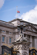 Following the official announcement of the death at age 99 of Prince Phillip, the Duke of Edinburgh, consort to Queen Elizabeth II, the Union Jack flag flies at half-mast on the roof of Buckingham Palace, on 9th April 2021, in London, Emgland.