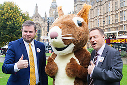 "Nature campaigners accompanied by a  giant red squirrel, Bob, urge MPs to ""Vote For Bob"" during a photocall outside Parliament. Their aim is to get MPs to support nature in Britain. PICTURED:  MPs Andrew Stephenson, left, and Jason McCartney pose with Bob the red squirrel."