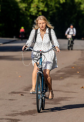 © Licensed to London News Pictures. 20/08/2020. London, UK. Calm after the storm. A Cyclist enjoys the warm sunshine in Hyde Park in Westminster this morning with highs of 25c expected for London and the South East, a day after the UK was battered by Storm Ellen which saw heavy downfalls and high winds. However, weather forecasters have predicted high winds for tomorrow as the UK continues to feel the force of the Atlantic storm. Photo credit: Alex Lentati/LNP