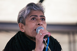 London, UK. 1st December, 2018. Nita Sanghera, Vice-President of the University and College Union (UCU), addresses the Together for Climate Justice demonstration against Government policies in relation to climate change, including Heathrow expansion and fracking. Following a rally outside the Polish embassy, chosen to highlight the UN's Katowice Climate Change Conference which begins tomorrow, protesters marched to Downing Street.