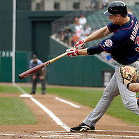 26 August 2007:  Minnesota Twins first baseman Justin Morneau (33) hits an RBI sacrifice fly to score center fielder Torii Hunter in the 1st inning against Baltimore Orioles pitcher Erik Bedard.  The Twins defeated the Orioles 11-3 at Camden Yards in Baltimore, MD.