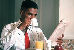 Businessman having breakfast