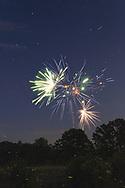 Fireworks above fireflies in farm fields in the Town of Hamptonburgh, N.Y., on July 4, 2020.