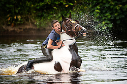 © Licensed to London News Pictures. 09/06/2017. Appleby UK. A young boy struggles to hold on to his horse at the Appleby horse fair that is taking place in the village of Appleby, the annual event dates back to the 18th century & see's travellers wash their horses in the River Eden. Photo credit: Andrew McCaren/LNP