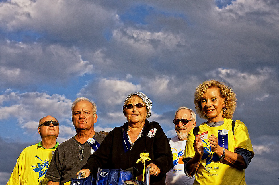 Photographer's Note: Everyone at the Relay for Life has similar reasons for being there. This image reflects a variety of emotions in its subjects: resolve and determination, hope, happiness and strength. I love how they are basked in early evening sunshine.