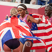 TOKYO, JAPAN August 3:  Gold medal winner Athing Mu of the United States, silver medal winner Keely Hodgkinson of Great Britain and bronze medal winner Raevyn Rogers of the United States celebrate after the Women's 800m Final at the Olympic Stadium during the Tokyo 2020 Summer Olympic Games on August 3rd, 2021 in Tokyo, Japan. (Photo by Tim Clayton/Corbis via Getty Images)