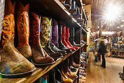 Boots on display in historic M.L Leddy's Boots, Fort Worth Stockyards National Historic District, Fort Worth, Texas, USA.
