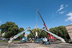© Licensed to London News Pictures. 22/08/2015. Bristol UK. The 50 tonne mechanical Arcadia 'spider' is dropped into Bristol's historic Queen Square by a 100 tonne tower crane. Next week on 04 and 05 September, Arcadia will host the world's first recycled biofuel pyrotechnics show to celebrate the city's year as European Green Capital. Photo credit : Simon Chapman/LNP