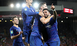 Chelsea's Emerson Palmieri (right) celebrates scoring his side's first goal of the game with team mates during the Carabao Cup, Third Round match at Anfield, Liverpool.