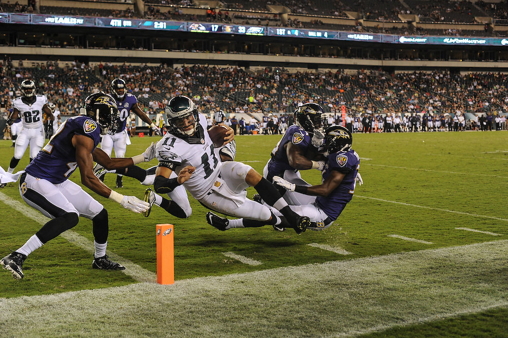 Philadelphia Eagles quarterback Tim Tebow (11) runs toward the goal line during the game against the Baltimore Ravens at Lincoln Financial Field on Aug 22, 2014 in Philadelphia, Pa. The Philadelphia Eagles won the game 40-17.(Photo by John Geliebter/Philadelphia Eagles)