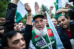 © Licensed to London News Pictures. 16/06/2019. Manchester, UK. Famous Pakistani fan and mascot Chaudhry Abdul Jalil (aka Chacha Cricket ) . Cricket fans outside Old Trafford Cricket ground where India and Pakistan are due to play in the ICC Cricket World Cup . Photo credit: Joel Goodman/LNP