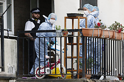 © Licensed to London News Pictures. 01/07/2020. London, UK. Scenes of crime officers work outside a block of flats in Monarch Parade in Mitcham, south London where a four year old girl was found seriously injured yesterday. She was taken to hospital where she later died. A woman, aged 35, is fighting for her life after she was also found suffering serious injuries inside the property. Photo credit: Peter Macdiarmid/LNP