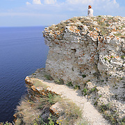 """Girl sitting on a rock of Devia hill and observing Volga reservoir in Russian National Park """"Samara Luka"""""""