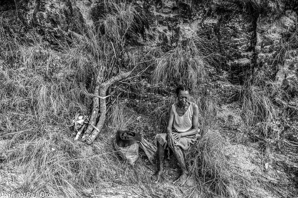 Fea0093883. DT News.The village of AntsevabeThe Ankeniheny-Zahamena Corridor, Madagascar.Pic Shows Locals at the village of Antesvabe collecting wood