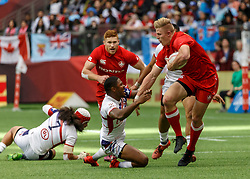 March 10, 2018 - Vancouver, British Columbia, U.S. - VANCOUVER, BC - MARCH 10: John Moonlight (#4) of Canada breaks out of a tackle and heads in to score during Game # 16- Usa vs Canada Pool A match at the Canada Sevens held March 10-11, 2018 in BC Place Stadium in Vancouver, BC. (Photo by Allan Hamilton/Icon Sportswire) (Credit Image: © Allan Hamilton/Icon SMI via ZUMA Press)