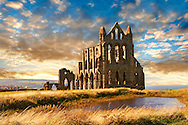 Medieval Gothic Whitby Abbey at sunset, Whitby, North Yrokshire, England .<br /> <br /> Visit our MEDIEVAL ART PHOTO COLLECTIONS for more   photos  to download or buy as prints https://funkystock.photoshelter.com/gallery-collection/Medieval-Middle-Ages-Art-Artefacts-Antiquities-Pictures-Images-of/C0000YpKXiAHnG2k
