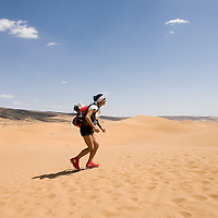 26 March 2007:  A participant runs across dunes during the second stage (21.7 miles) of the 22nd Marathon des Sables between Khermou and jebel El Otfal. The Marathon des Sables is a 6 days and 151 miles endurance race with food self sufficiency across the Sahara Desert in Morocco. Each participant must carry his, or her, own backpack containing food, sleeping gear and other material.