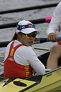 Munich, GERMANY, 2006, FISA, Rowing, World Cup, CHN W8+ cox, Na Zheng, checks as the boat is connected to the start pontoon,  on the Olympic Regatta Course, Munich, Thurs. 25.05.2006. © Peter Spurrier/Intersport-images.com,  / Mobile +44 [0] 7973 819 551 / email images@intersport-images.com..[Mandatory Credit, Peter Spurier/ Intersport Images] Rowing Course, Olympic Regatta Rowing Course, Munich, GERMANY