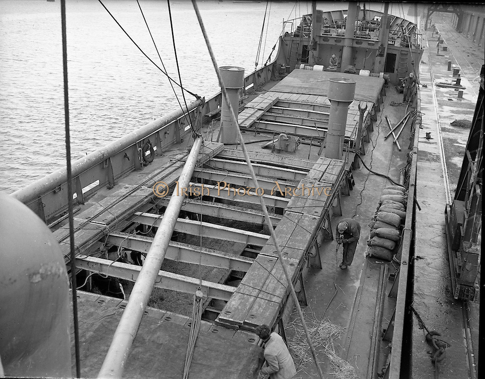 """The """"City of Waterford"""" sails from Dublin with a cargo of horses for export. Men prepare the top of the deck for departure on the 17th January 1960."""
