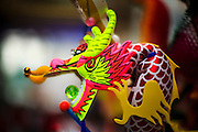 """10 FEBRUARY 2013 - BANGKOK, THAILAND:  A Chinese toy for sale during Chinese New Year celebrations on Yaowarat Road in Bangkok. Bangkok has a large Chinese emigrant population, most of whom settled in Thailand in the 18th and 19th centuries. Chinese, or Lunar, New Year is celebrated with fireworks and parades in Chinese communities throughout Thailand. The coming year will be the """"Year of the Snake"""" in the Chinese zodiac.   PHOTO BY JACK KURTZ"""