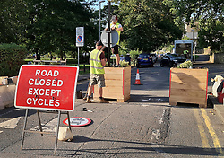 © Licensed to London News Pictures. 14/09/2020. London, UK. Workman assemble planters and attach signs to a Low Traffic Neighbourhood (LTN) scheme on Lower Ham Road near Kingston-Upon-Thames in London. LTN schemes have caused traffic to re-route to other areas with residents complaining to local authorities. The London Borough of Wandsworth have scrapped LTN trials after a review by the council. Photo credit: Peter Macdiarmid/LNP