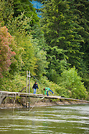 Sisters Kim and Terrie Brigham fishing from their family platforms on the Columbia River at Cascade Locks, Oregon