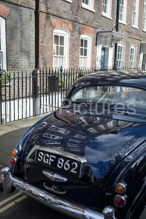 A 1964 Empress Bentley is parked in Smith Square, a small square behind the Houses of Parliament, before collecting their VIP passengers - barristers who are being sworn in as QCs aka Silks in legal vernacular, on 11th March 2019, in London, England.