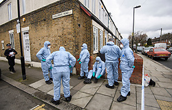 © Licensed to London News Pictures. 03/04/2018. London, UK. Member son a police search team prepare to search the scene on Chalgrove Road, Tottenham, north London where a 17 year old girl was shot dead. The girl was found with a bullet wound and pronounced dead at the scene at 21:43 last night. Photo credit: Ben Cawthra/LNP