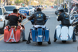Three beautiful custom Harley-Davidson baggers pause briefly on Dr. Mary McLeod Bethune Boulevard at the heart of what has come to be known as Black Bike Week during Daytona Bike Week. Daytona Beach, FL. USA. Thursday March 16, 2017. Photography ©2017 Michael Lichter.
