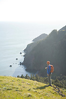 Young man hiking in the Marin Headlands. Golden Gate National Recreation Area. San Francisco, CA