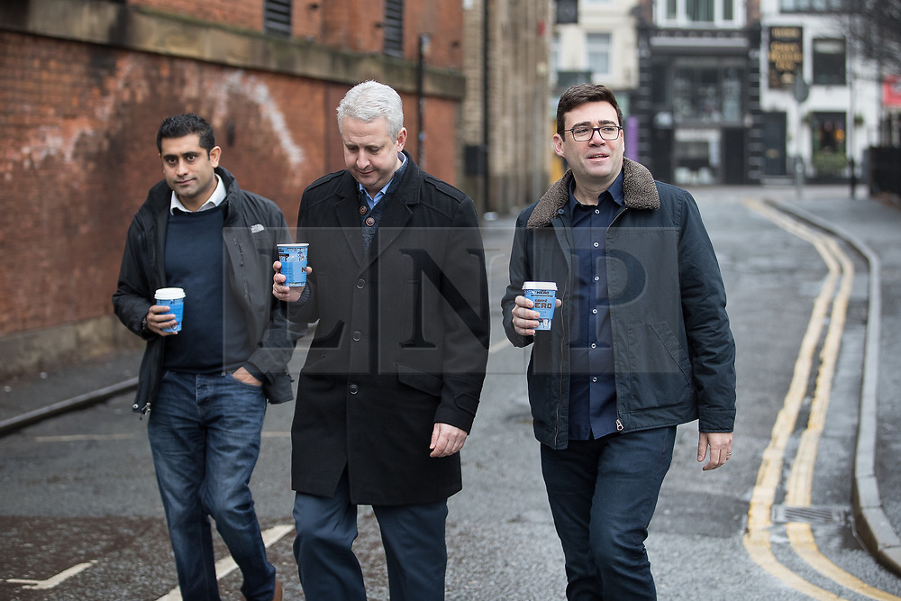"""© Licensed to London News Pictures. Manchester , UK . FILE PICTURE DATED 07/01/2017 of RISHI SHORI (leader of Bury council) , IVAN LEWIS MP and ANDY BURNHAM carrying Caffe Nero coffees when arriving for a campaign launch event for Andy Burnham's candidacy of Mayor of Greater Manchester, at the Mechanics' Institute in Manchester. Mr Burnham wrote on twitter """" Bit bizarre hearing these right-wing calls for a 'Barista Visa'. God forbid the idea of waiting longer in the morning for their posh coffee """". Photo credit: Joel Goodman/LNP"""