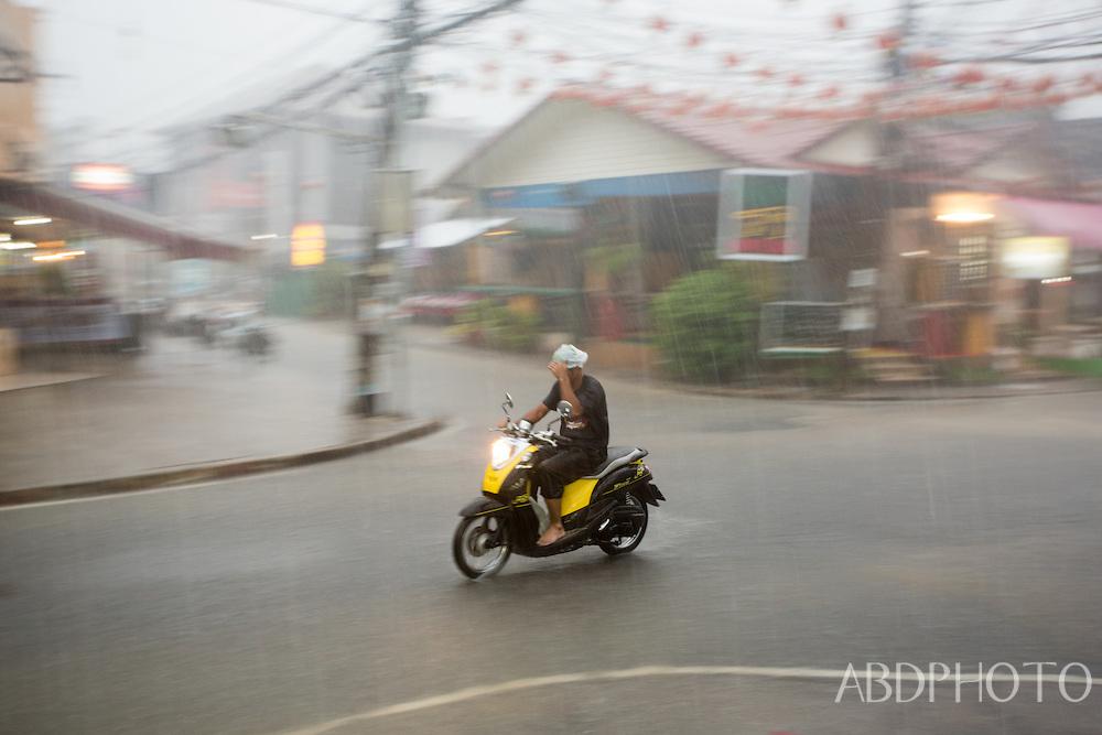 motorbike in rainy season, lamai, koh samui, thailand