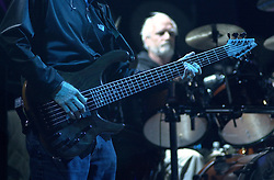 Phil Lesh playing his Bass with Billy in the background. The Dead in concert at the Tweeter Center, Mansfield MA 22 June 2003