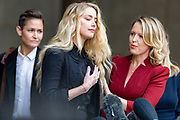 "American actress and model Amber Heard gives a statement in front of the Royal Courts of Justice in central London on Tuesday, July 28, 2020.<br /> An article in the Sun describing Johnny Depp as a ""wife-beater"" was ""one-sided"" and ""not researched at all"", the actor's lawyer told the High Court. In closing submissions for Mr Depp, David Sherborne said the paper acted as ""both judge and jury"". Mr Depp is suing the newspaper's publisher and editor for libel, saying the allegation is ""completely untrue"". (VXP Photo/ Vudi Xhymshiti)"